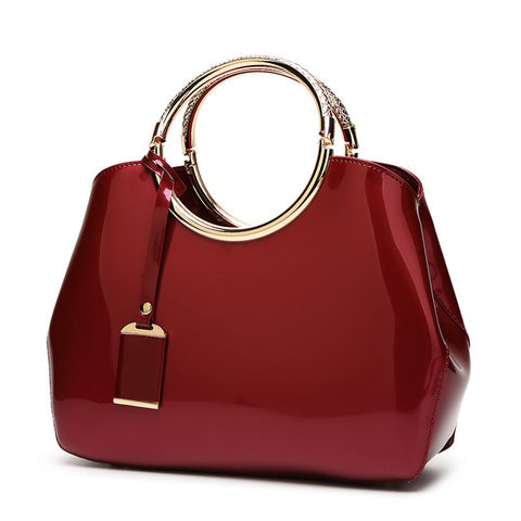 LindsiAlexander.com - Patent Leather Silver Accented Handbag in Red Wine