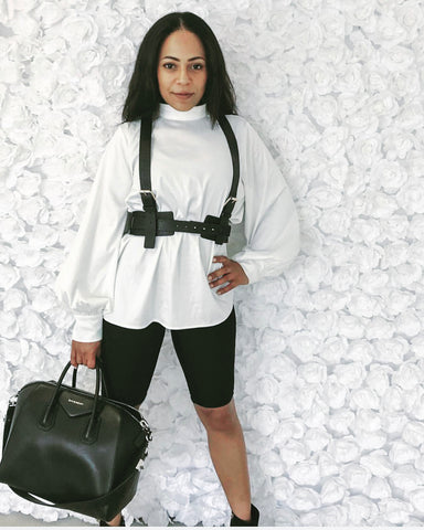cycling shorts with white blouse and harness