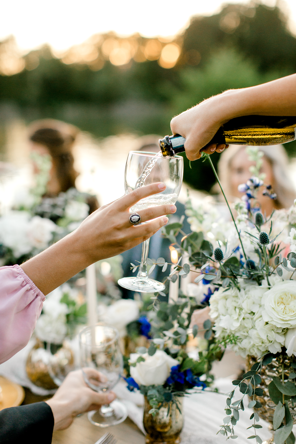 toasting glasses at a rehearsal dinner