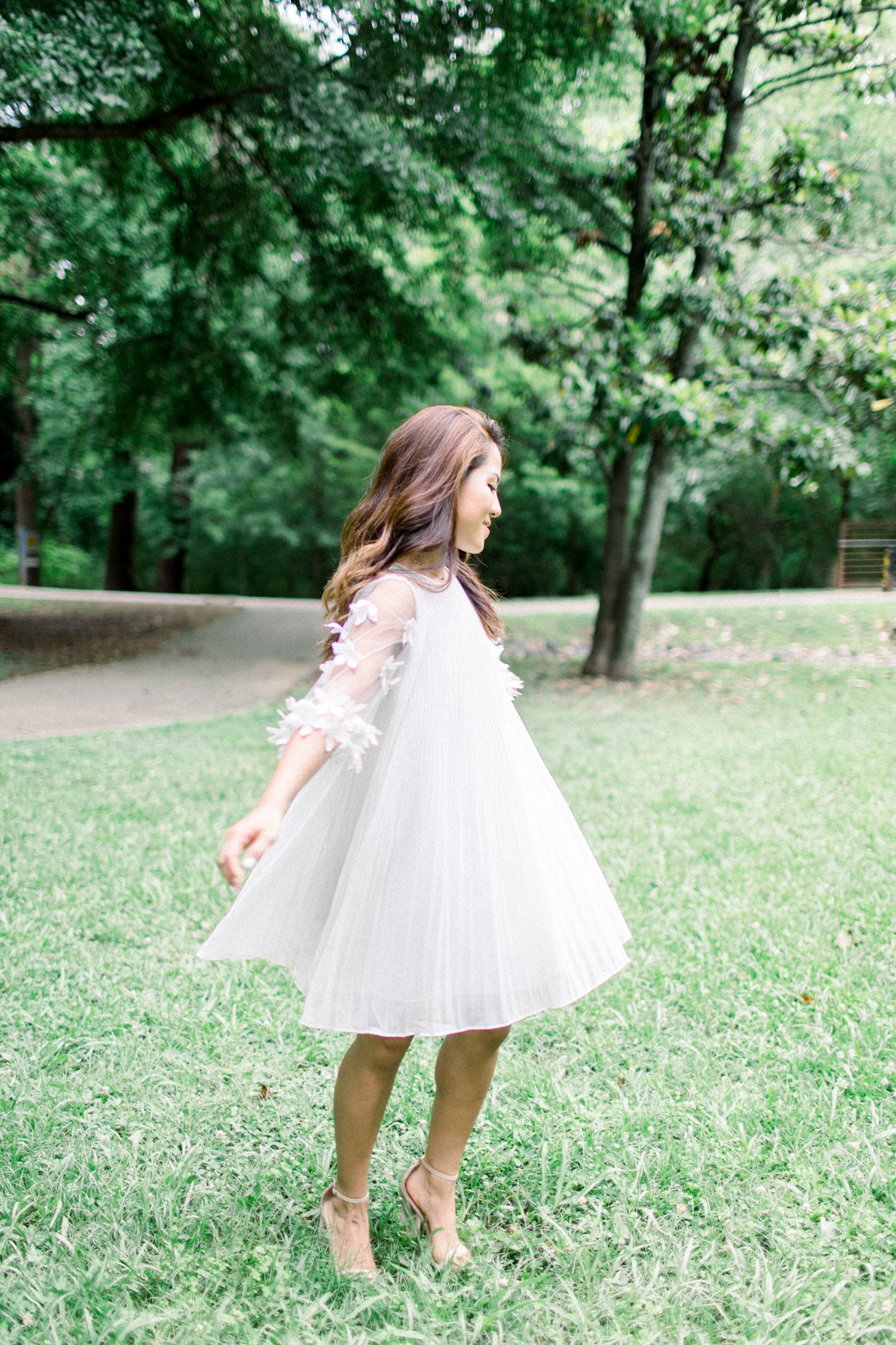 white pleated bridal shower dress with floral sleeves