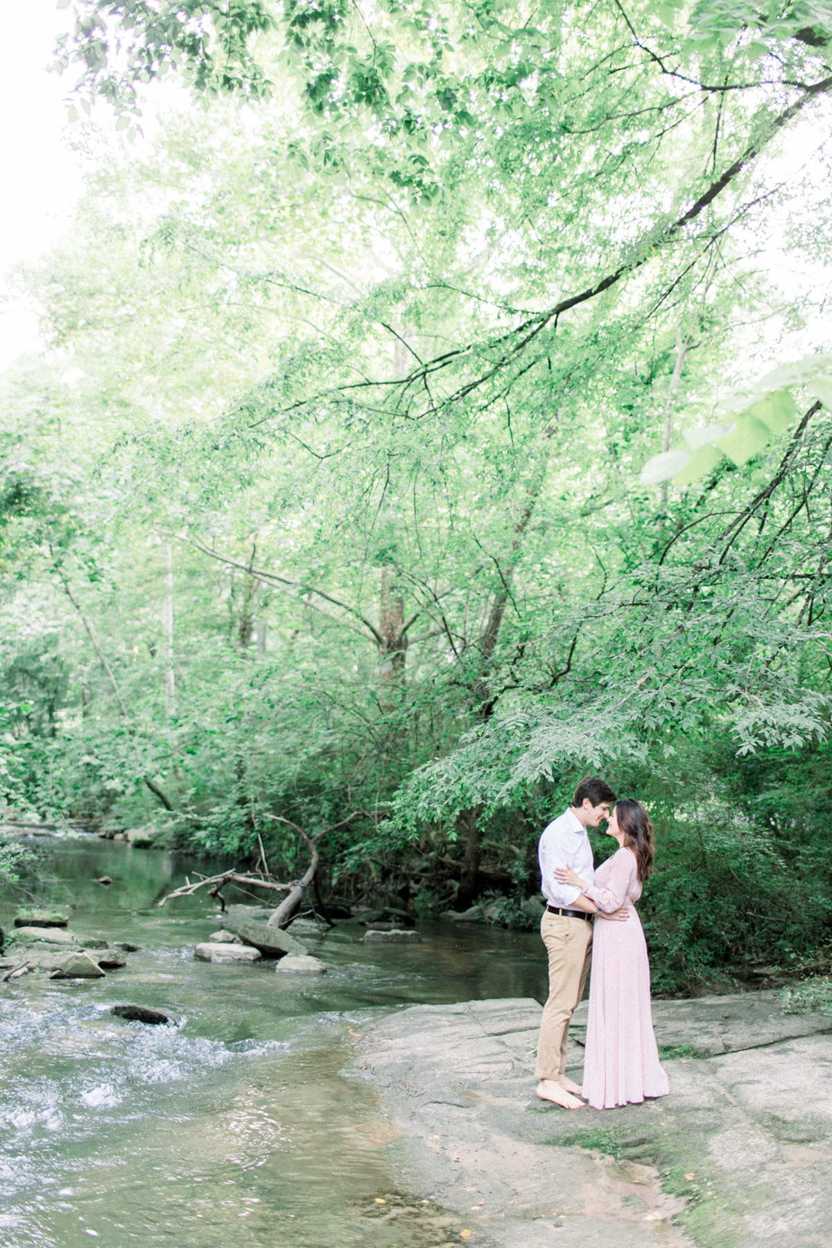 Engagement photos at Tanyard Creek Park in an Eternal Ivory dress