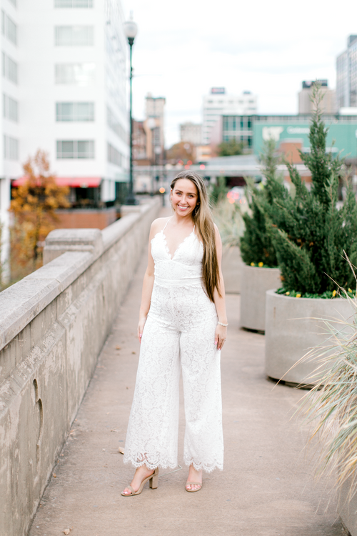 Bride wearing white lace jumpsuit | Bridal shower, bachelorette party, or engagement dress | The Blakely | Eternal Ivory