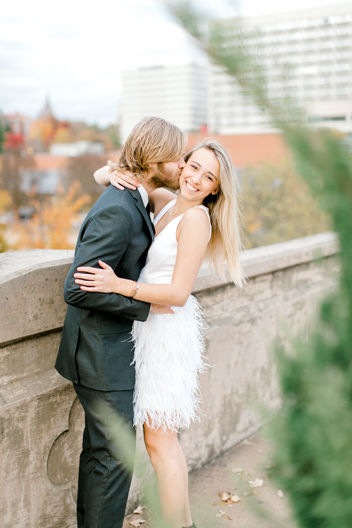 Engaged couple kissing during holiday engagement photos | The Lily Dress | Eternal Ivory