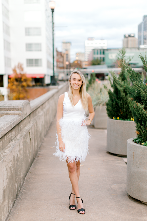 Bride-to-be wearing white dress with feather skirt | New Year's, holiday, or engagement dress | The Lily | Eternal Ivory