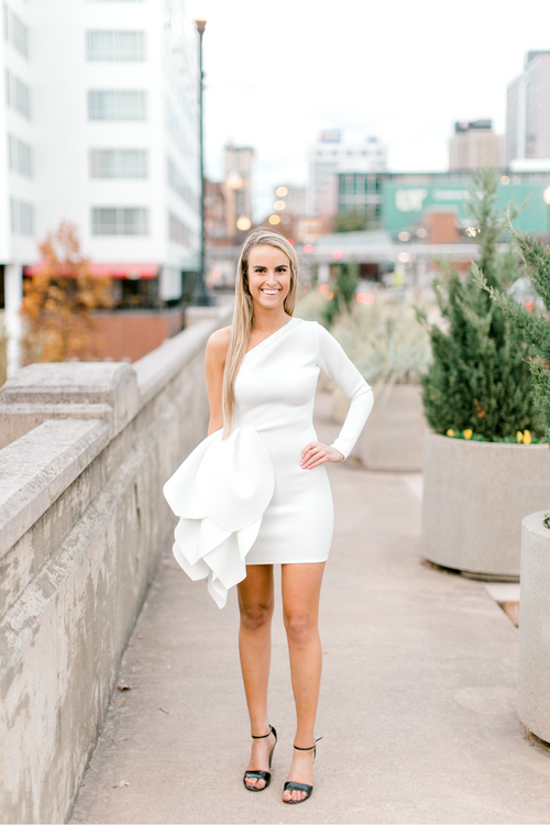 Bride-to-be wearing white bodycon mini dress with tulip detailing | Engagement dress | The Savannah | Eternal Ivory