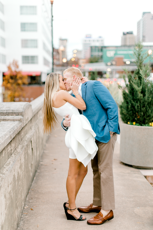 Romantic kiss between engaged couple| Engagement photos | Bride in a white engagement dress | The Savannah | Eternal Ivory