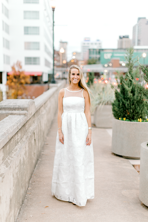 Bride wearing long white dress with floral embroidery | Rehearsal dinner dress | Engagement dress | The Grace | Eternal Ivory