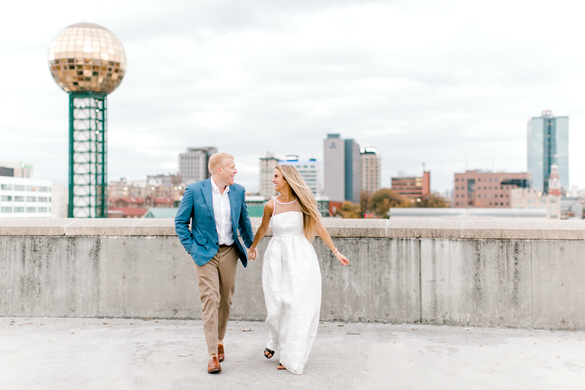 Engaged couple running in their engagement photos | Bride wearing white gown | Knoxville, TN | The Grace | Eternal Ivory
