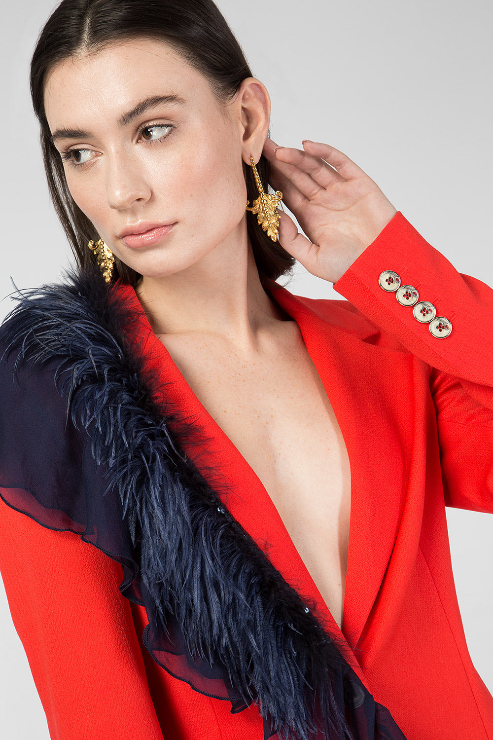 Red suit with ruches and feathers