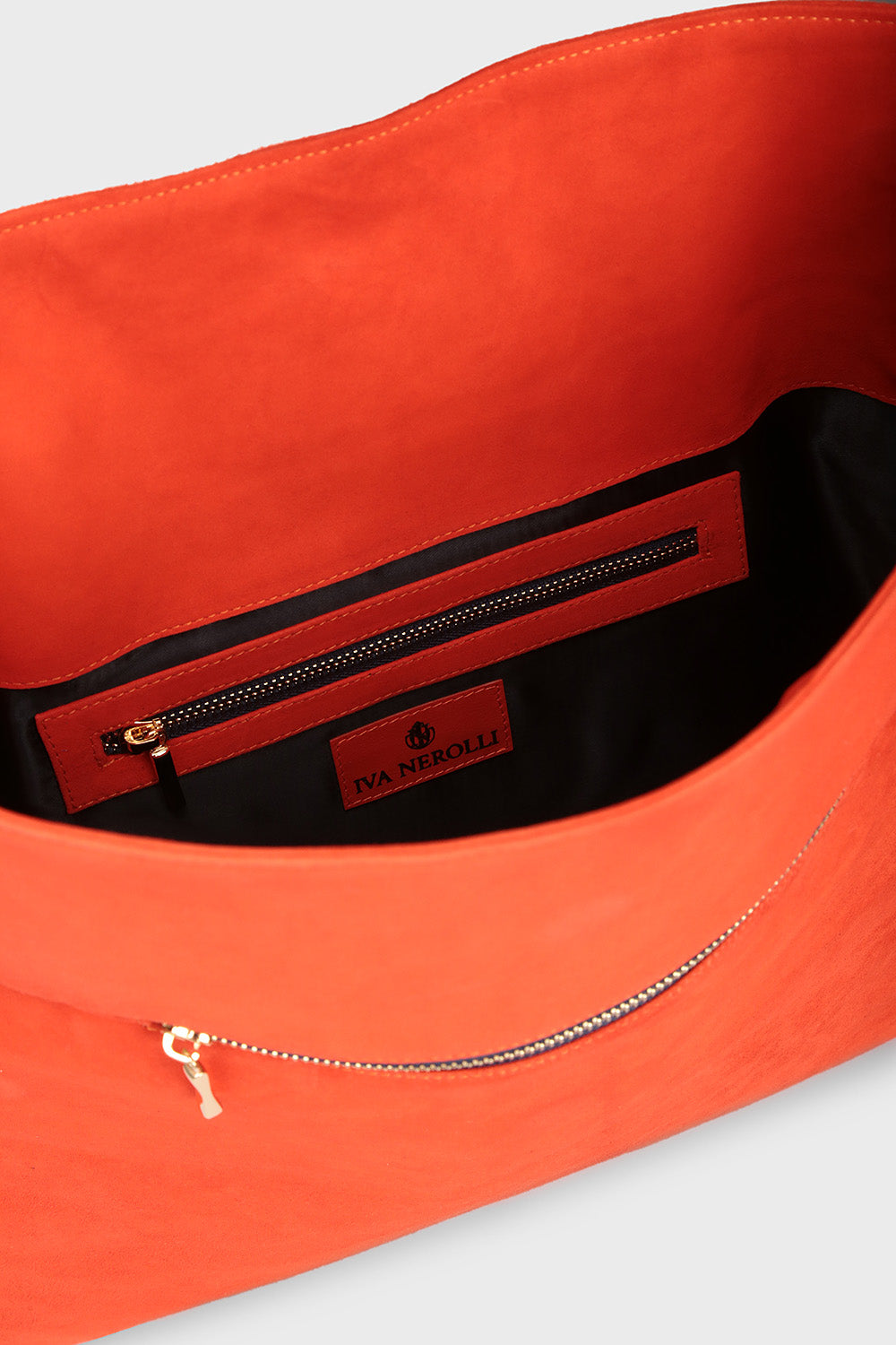 Orange suede clutch