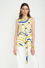 White print sleeveless blouse with belt