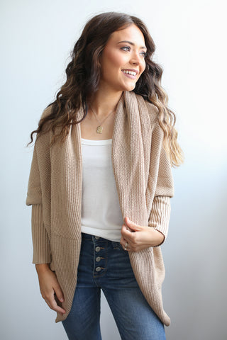 Long sleeve ribbed knit open front sweater cardigan with tapered fit sleeve. So flattering!