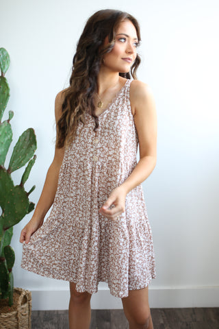 Woven ditsy floral print slip dress with round neckline. The Girls in Grey