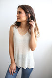 Knit tank - Sleeveless shoulder straps - Scooped neckline - Scalloped hem - Loose-fitting. Available in cream and black.