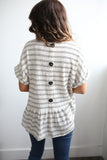 Back-button detail peplum striped knit top.