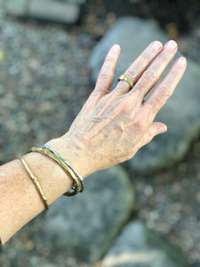 Out in the yard with some of our bronze and silver bangles and a bronze thumbprint ring