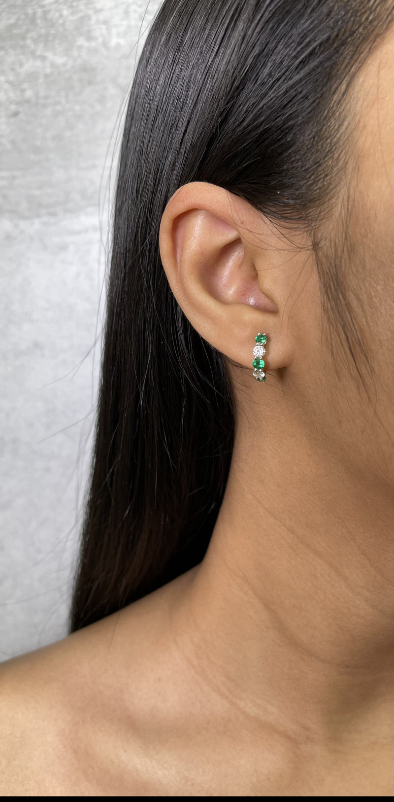 Shared Prong Diamond and Emerald Huggie Earrings - R&R Jewelers
