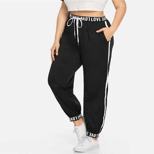 ROMWE Plus Size Letter Print Waist Drawstring Pants Ladies Black Casual Loose Spring Fall Female Sporty Tapered Carrot Trousers
