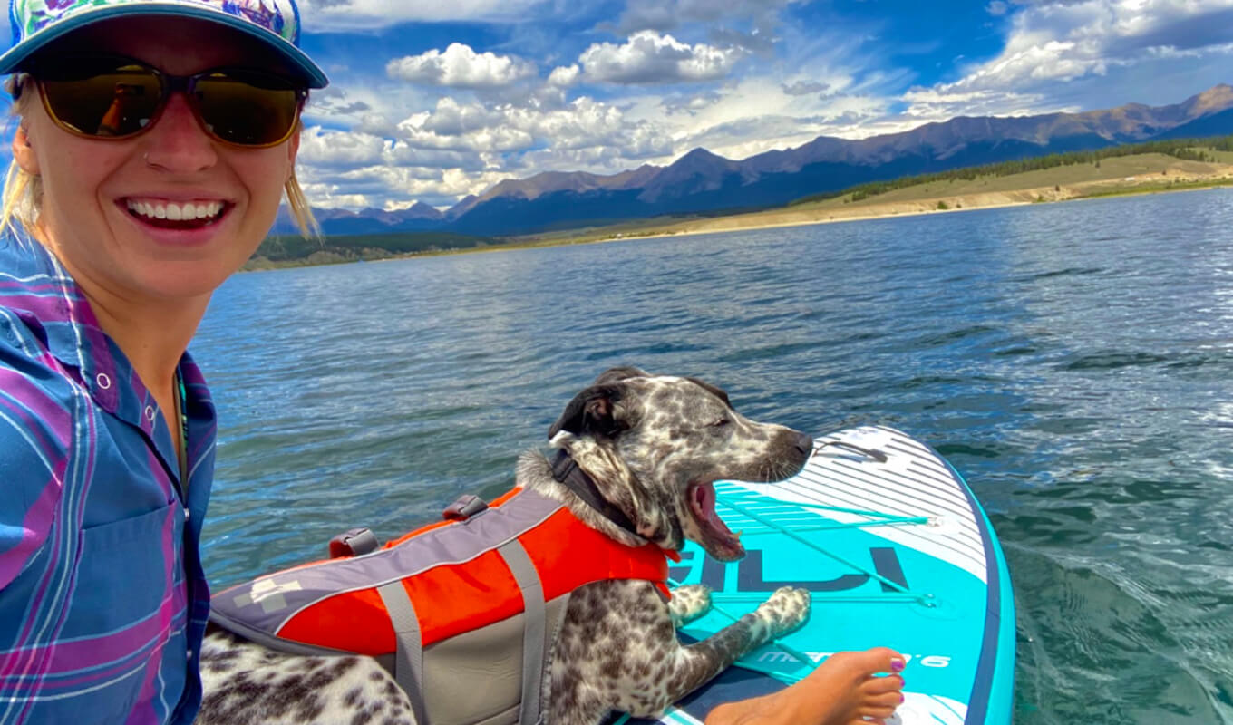 Woman with her dog on a life jacket