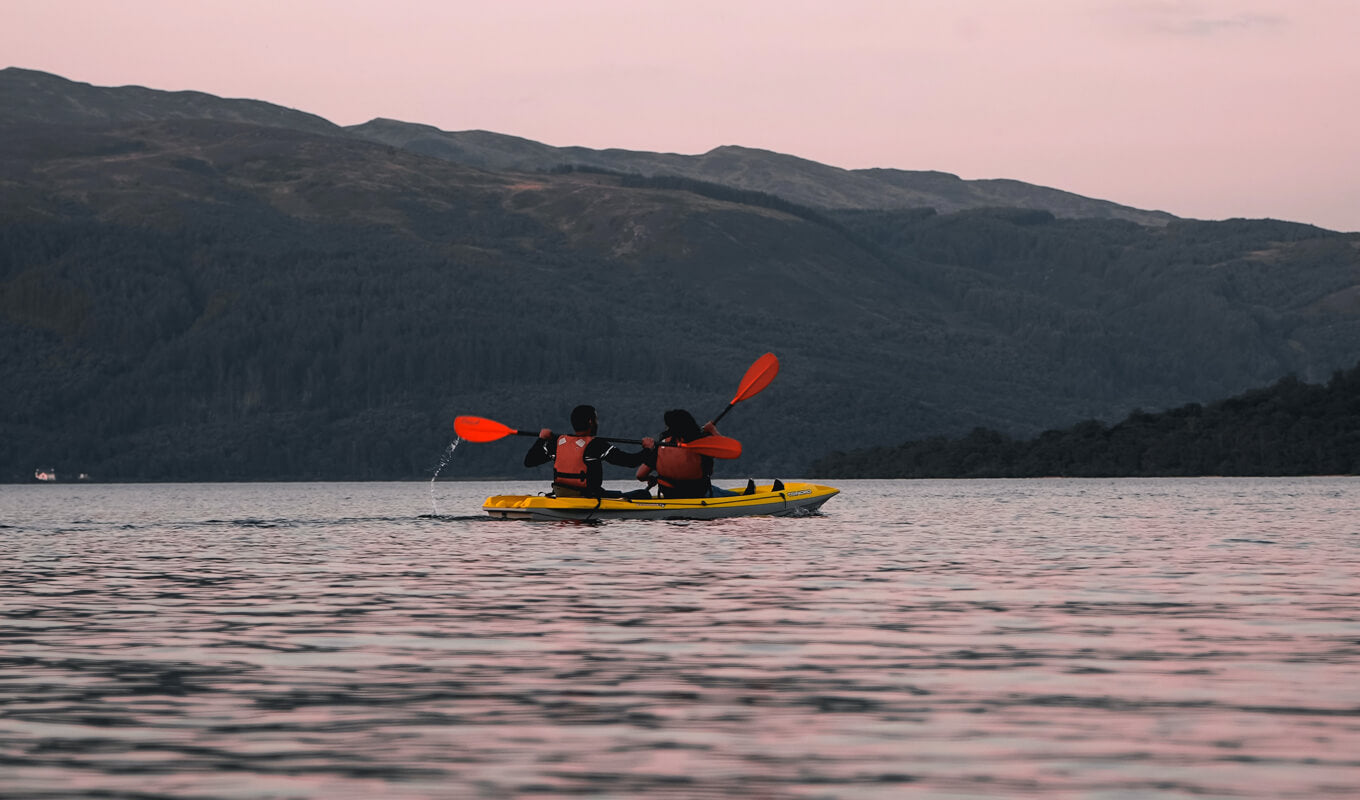 Man and a woman on a tandem kayak