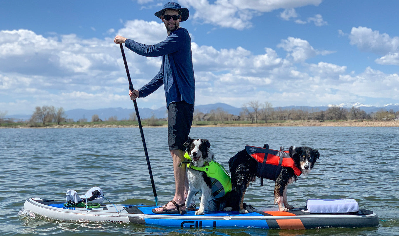 Best paddle board for dogs - man and two dogs