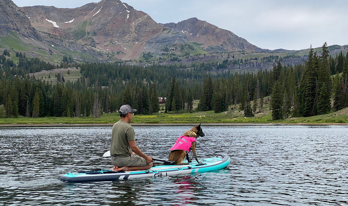 Best paddle board for dogs - man kneeling