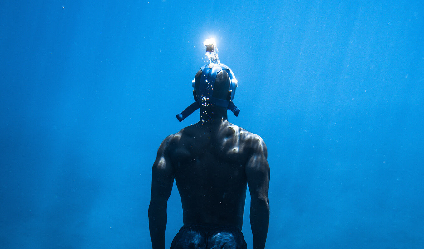 Man snorkeling using a full face mask