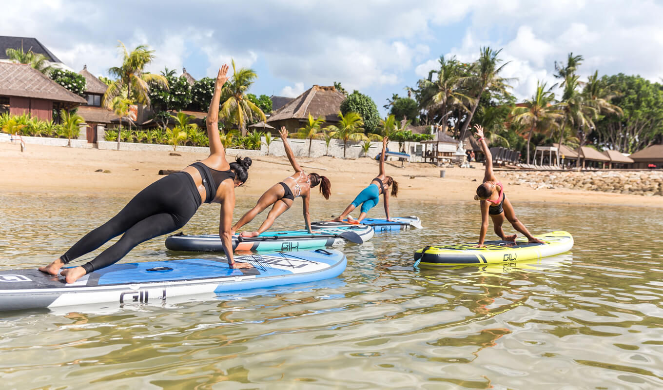 Yoga poses on a paddle board