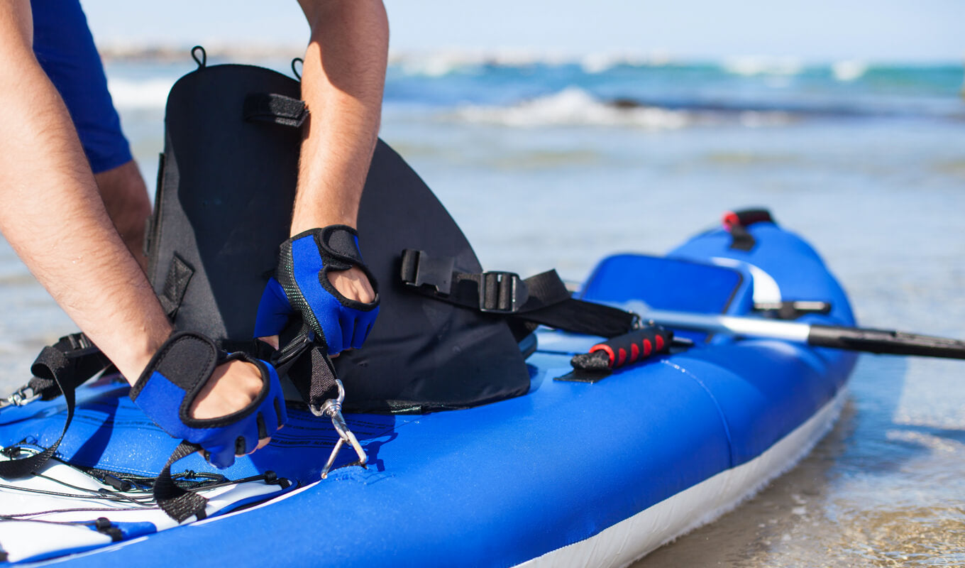 Blue inflatable kayak with accessories