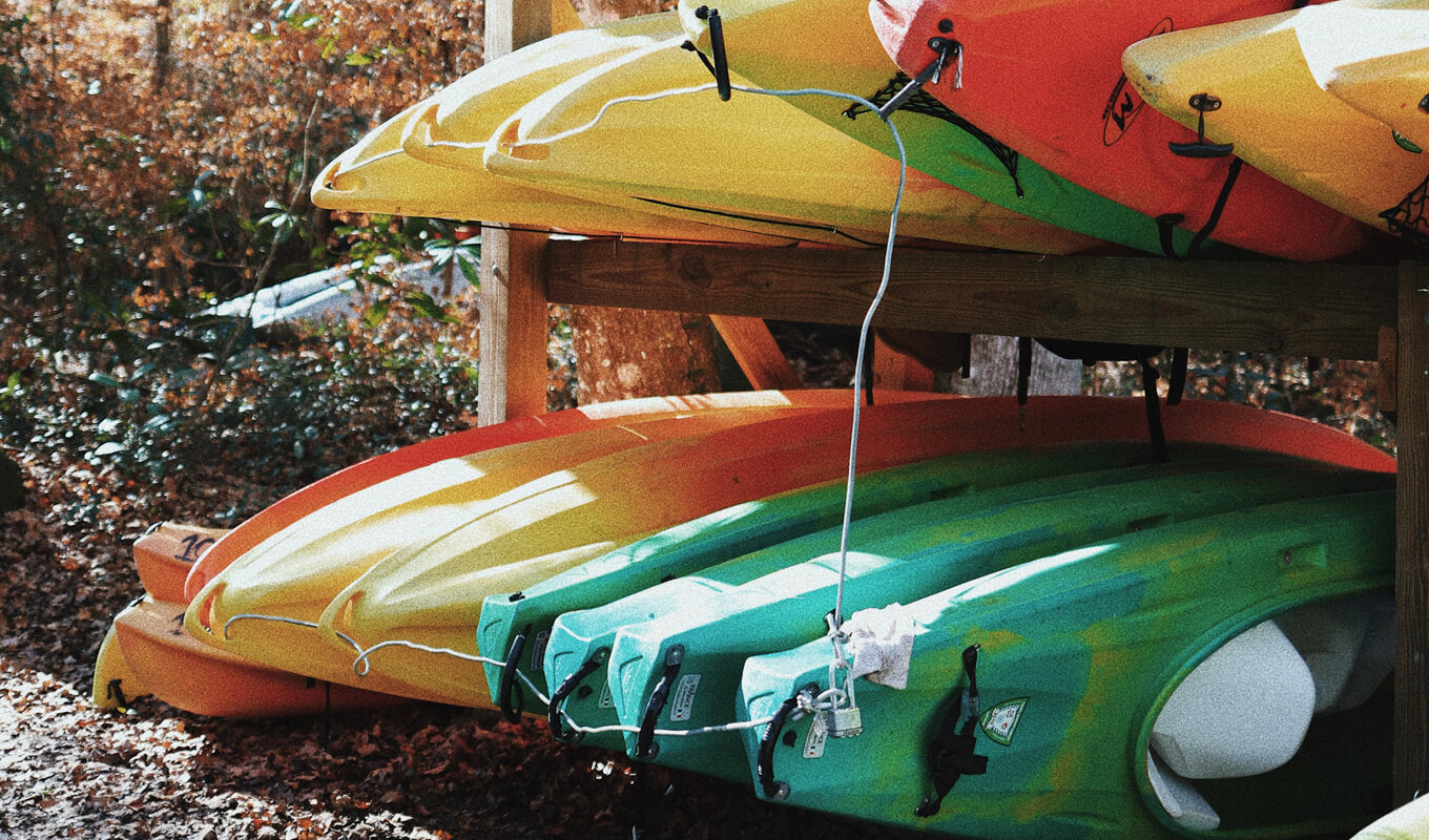 Different kayaks on a rack