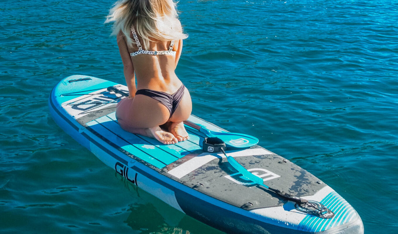 Women on an SUP board with ankle leash