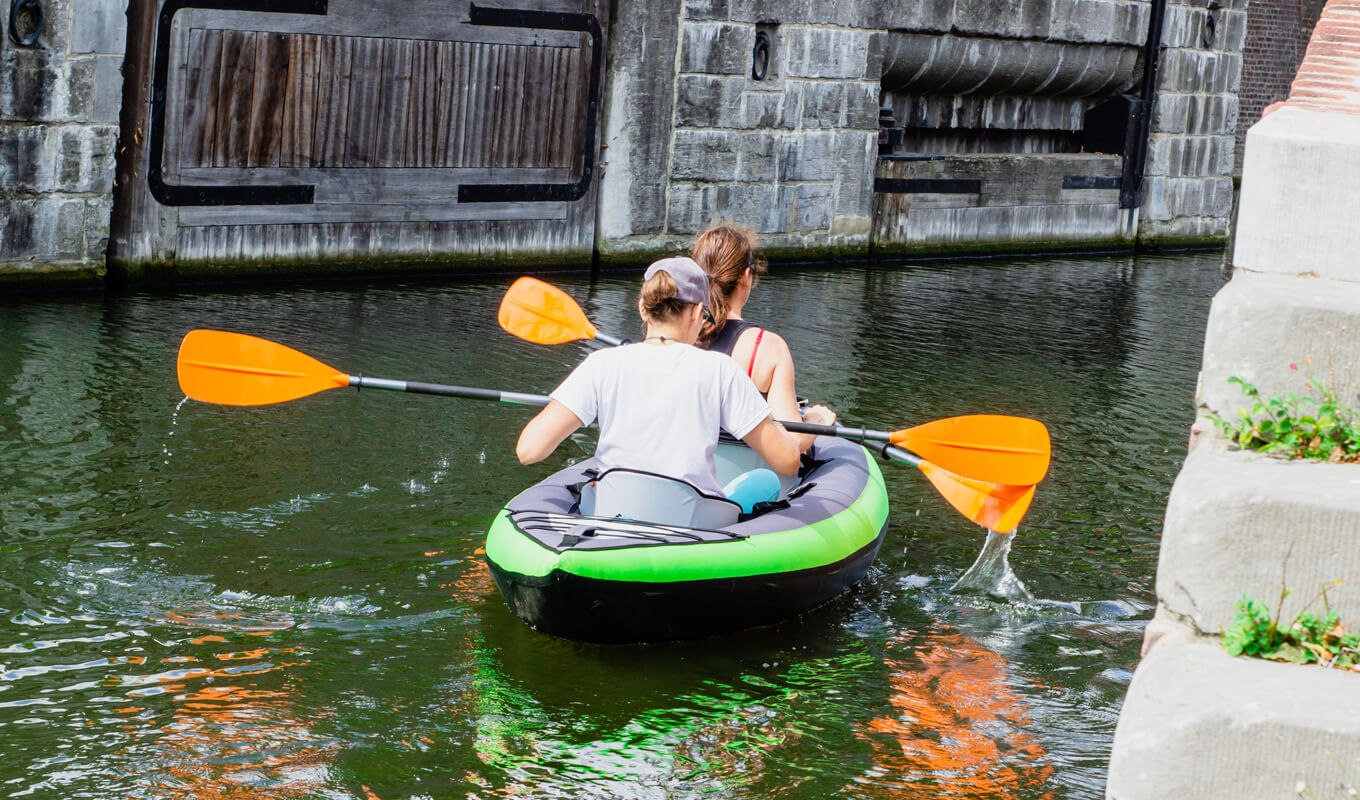 Tandem inflatable kayak on body of waters