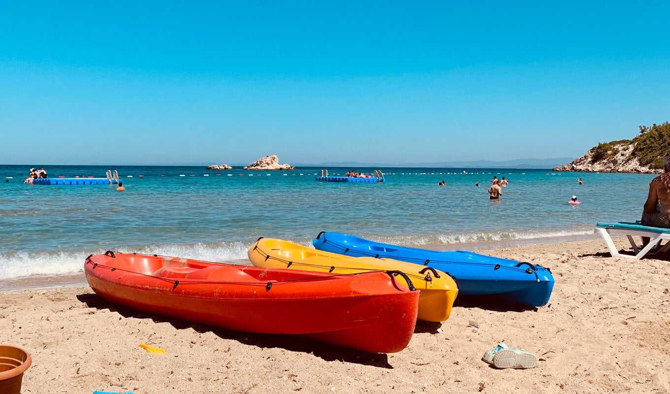 Three kayak on a different color on a beach