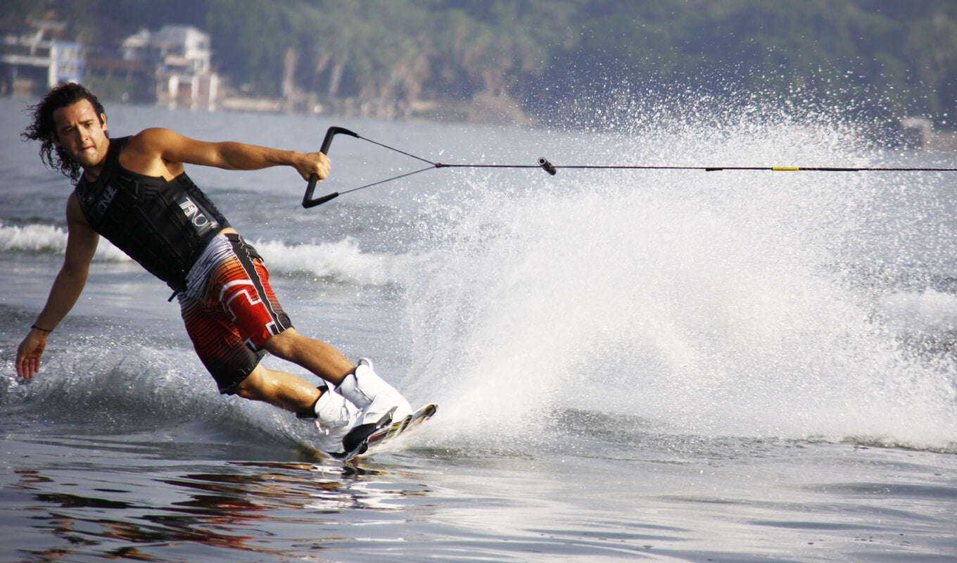 Man in Black life jacket and Red Shorts Wakeboarding