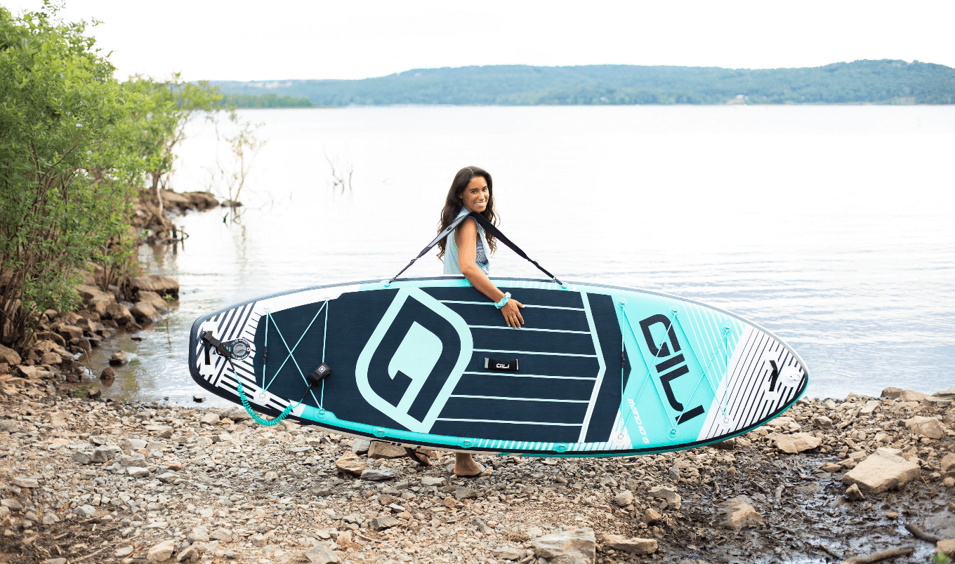 best paddle boards for beginners - girl with board