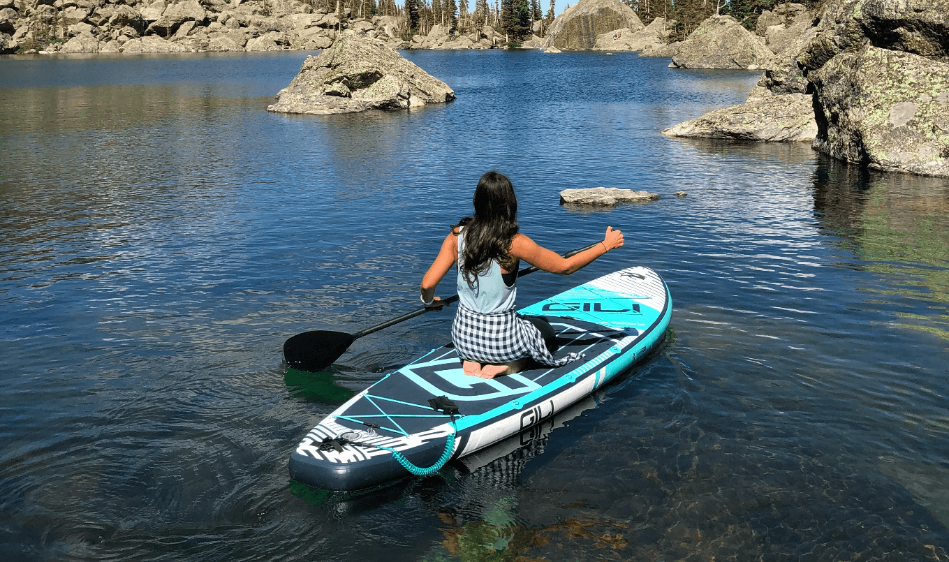 best paddle boards for beginners - on knees