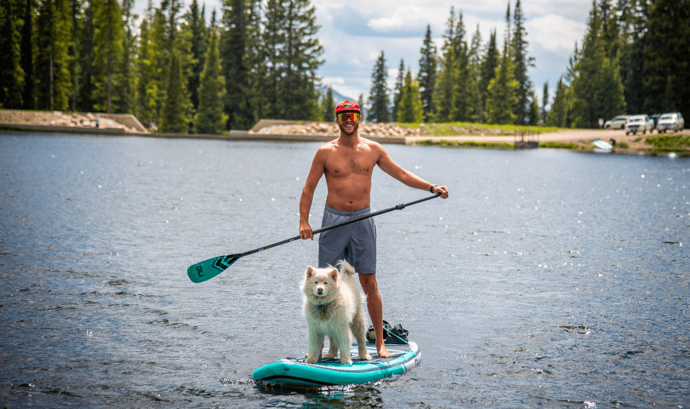how to paddle board with your dog - man and pup