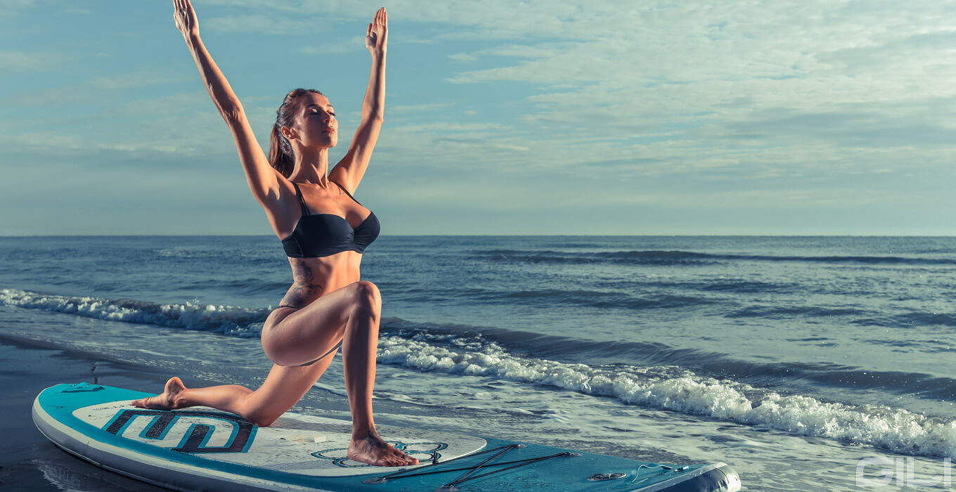 Crescent Lunge High Lunge Yoga Pose on a Paddle Board