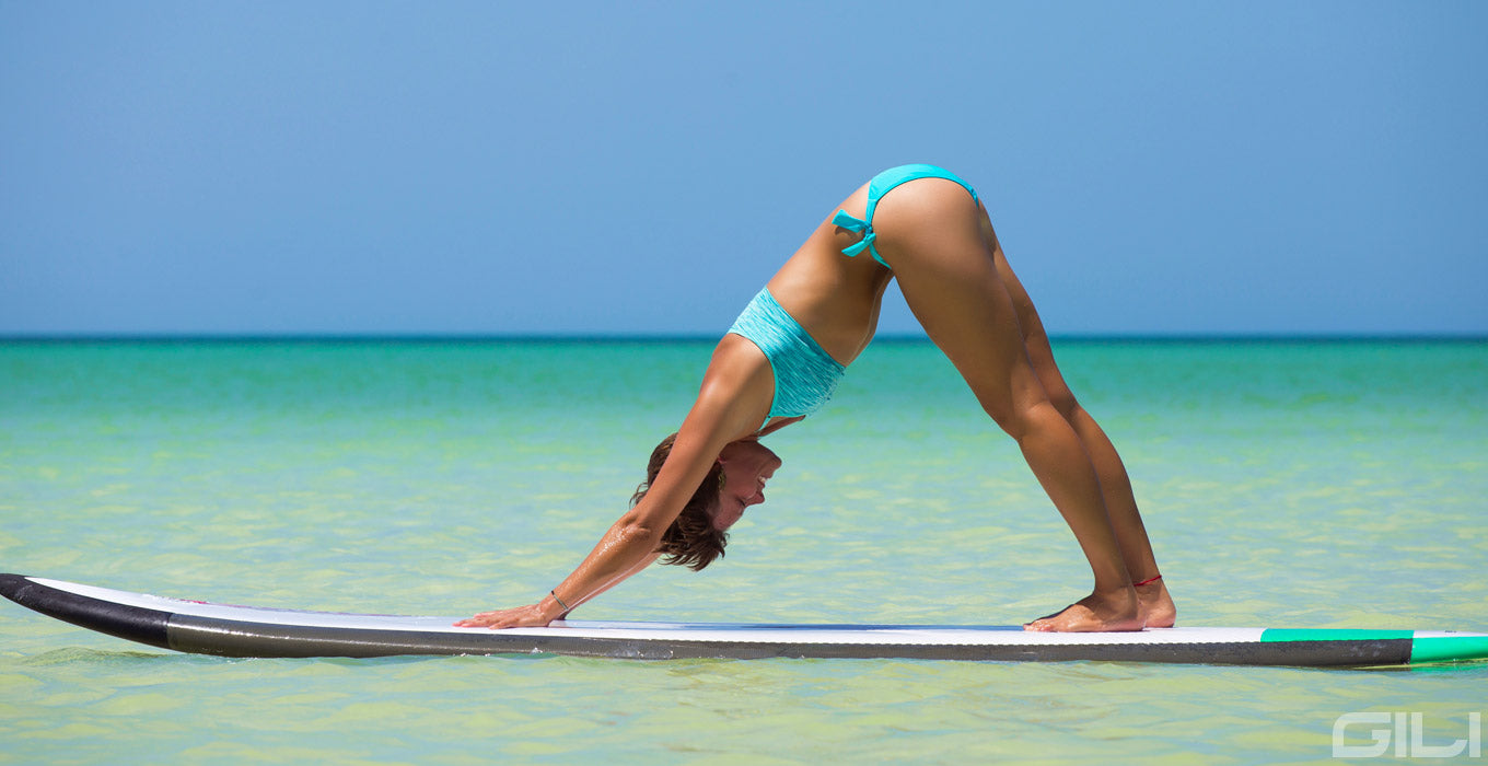 Downward Facing Dog Yoga Pose on a Paddle Board