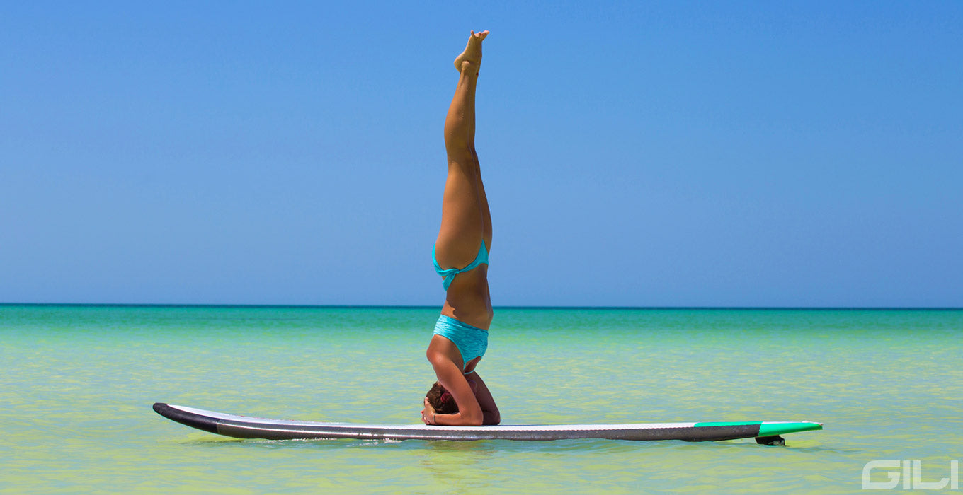 Supported Headstand Yoga Pose on a Paddle Board