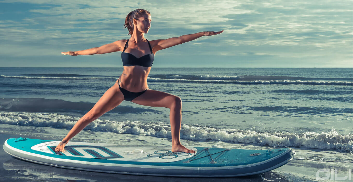 Warrior Yoga Pose on a Paddle Board