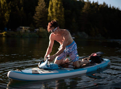 11' Adventure Inflatable Paddle Board on the water