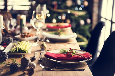 Photograph of a holiday-themed table with plates and napkins.