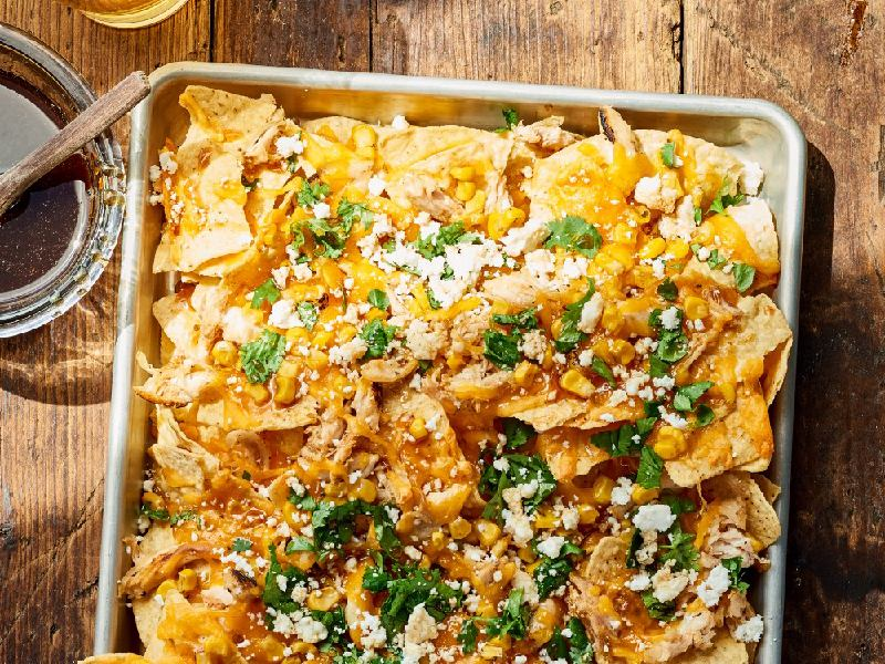 PULLED CHICKEN NACHOS WITH BBQ INFUSED HONEY
