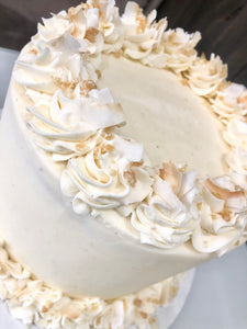 Creamy Coconut Cake layered with Crunchy macadamia coconut toffee crumbles