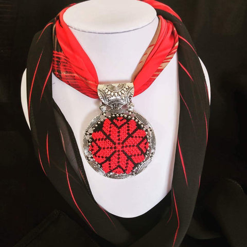 Handmade black and red scarf with embroidered pendant
