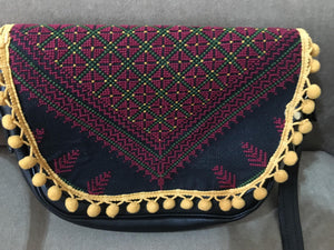 Hand embroidered black handbag with red embroidery