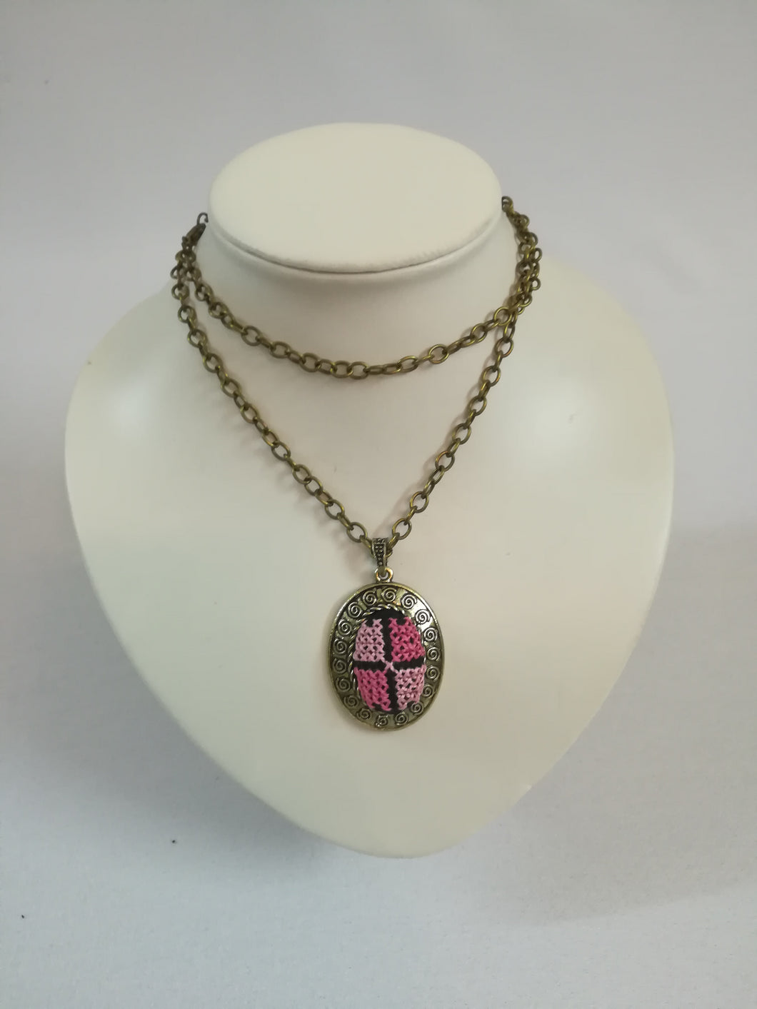 Golden color necklace with pink embroidered pendant - Falastini Brand