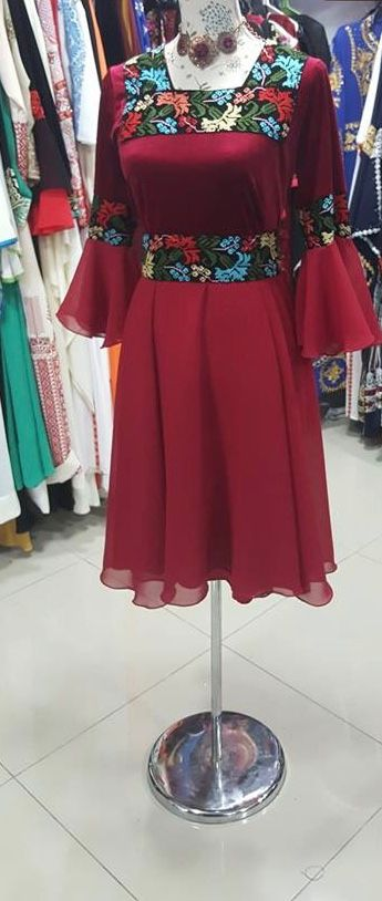 Short embroidered red dress with matching embroidered belt