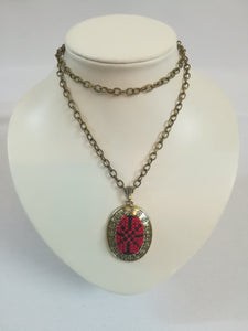 Golden color necklace with red embroidered pendant - Falastini Brand